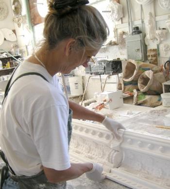 An artisan working on her craft.