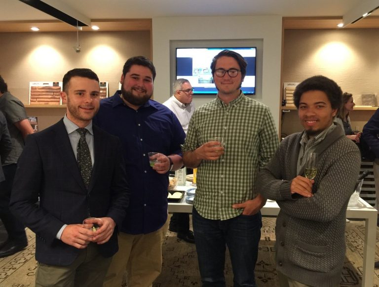 Four men at a New Classicists event.